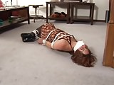 Mature Lady tied and gagged on floor