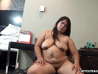 Chunky Asian babe rubbing her fat tacco thinking she's sexy