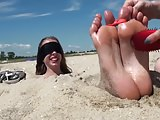 Blindfolded and tickled on the beach