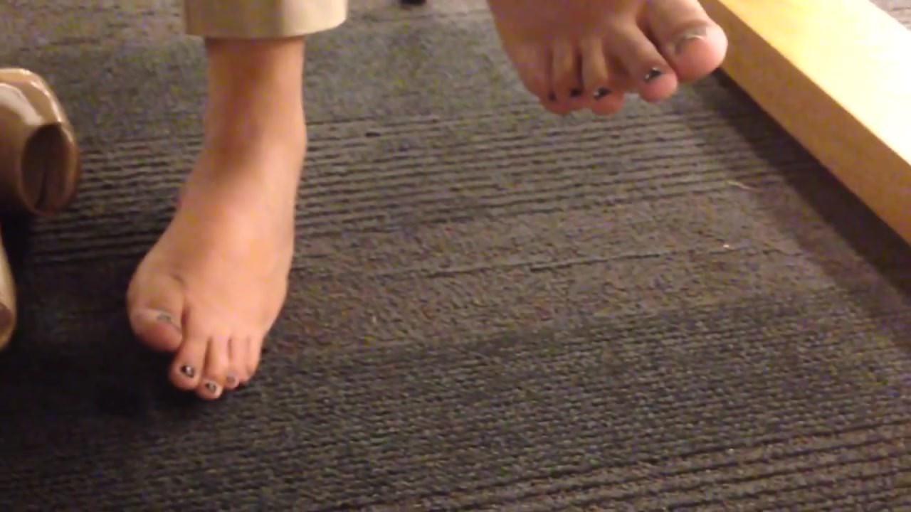 Candid Feet under table faceshot