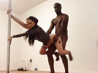 Interracial couple and dancing pole