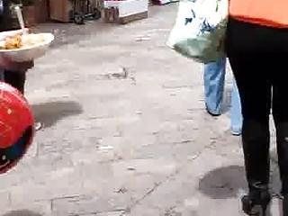 MILF walking in black boots leggings