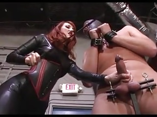 Femdom Latex Mistress video: Mistress Beating A Slaves Cock And Balls