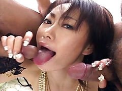 Arousing brunette has a pair of cocks on her hands