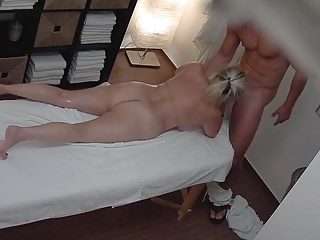 Milfs Big Boobs xxx: busty mature blonde in a massage parlor