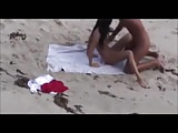 Blond guy fucks brunette on beach