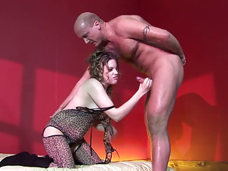 Passionate doll swallows a massive cock down her throat in a reality shoot