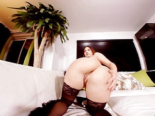 Saucy hussy uses a fake plastic cock to plug her deep well