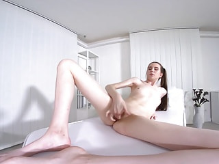 Brunette climbs on the table to play with pussy