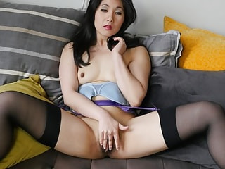 Stockings over Fishnet Pantyhose on an Asian Tease