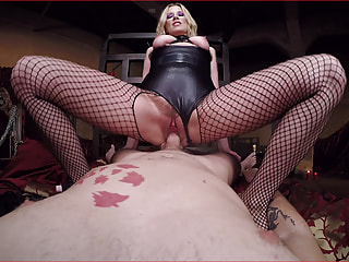 Kinky Mistress in Leather Gives a Sexy Footjob