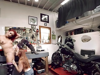 Lesbian Biker Babe Licks Tight Pussy in the Garage